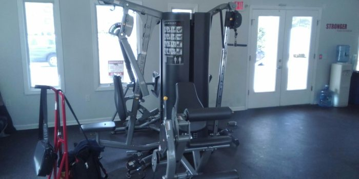 Fitness Machine Technicians repair a weight machine in Plainsboro