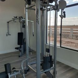 Strength training machine next to window