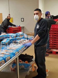 Ricardo volunteering at Chicago's Food Bank