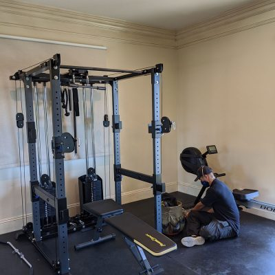 Technician after assembling both rowing and strength machine