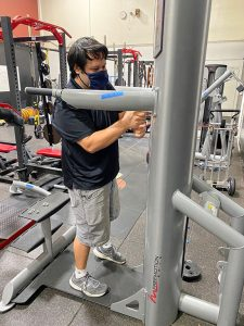 Technician assembles fitness machinery in Westminster, California